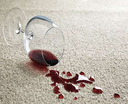 Wine stained carpet in need of carpet cleaning